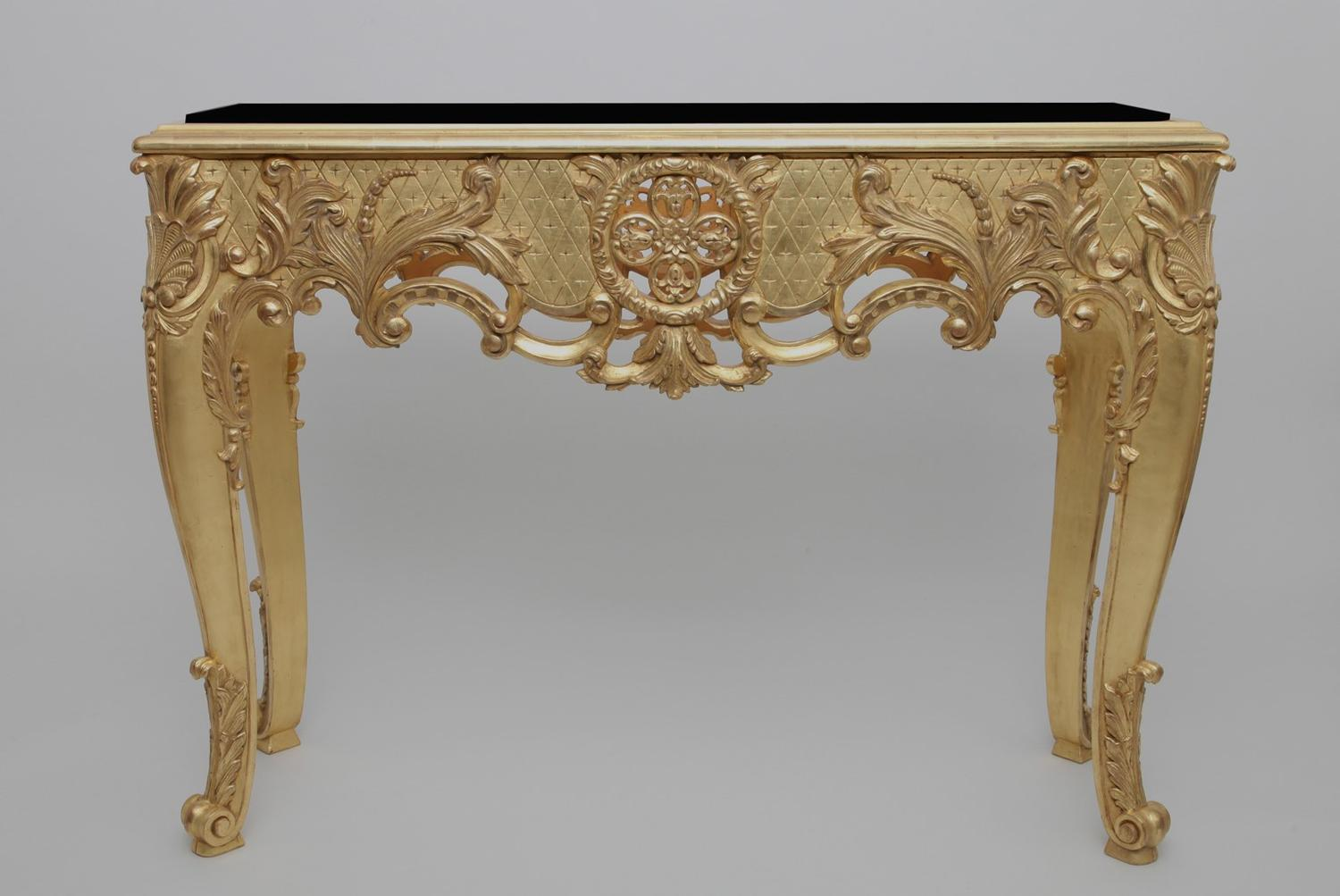 Gold console with black tray