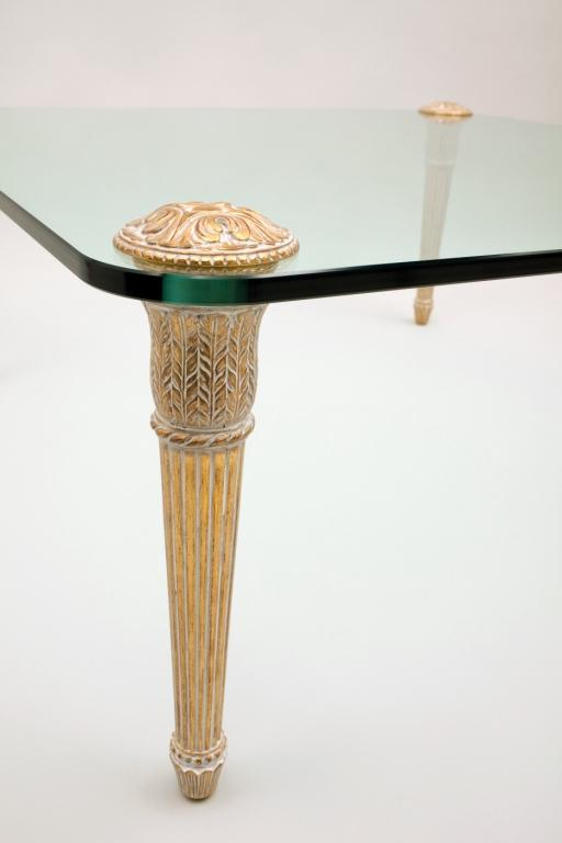 Gilded coffee table with a glass top